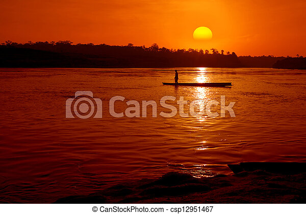 Fisher boat in the river with sunset - csp12951467