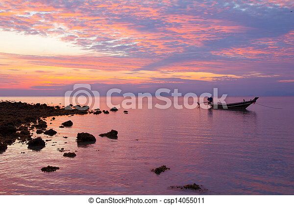 Fisherman boat at sunset - csp14055011