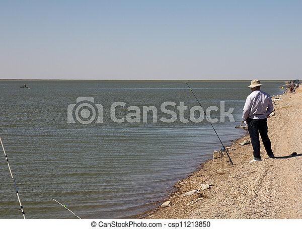 Fisherman fishing on the lake - csp11213850
