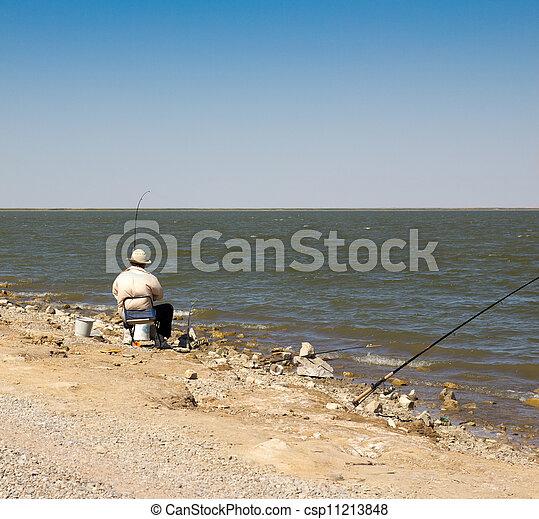 Fisherman fishing on the lake - csp11213848