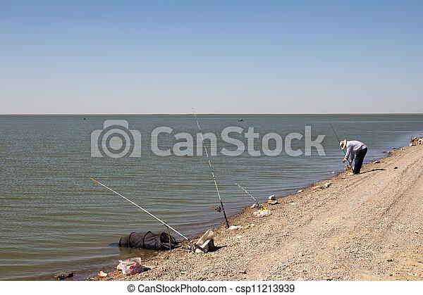 Fisherman fishing on the lake - csp11213939