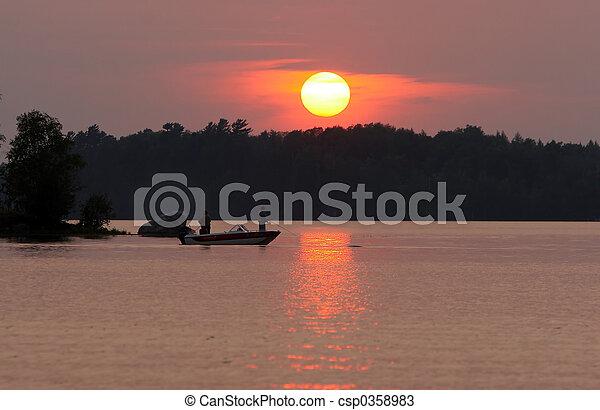 Fishermen at sunset - csp0358983