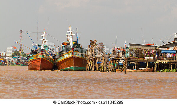 Fishermen boats in a river in the Mekong Delta - csp11345299