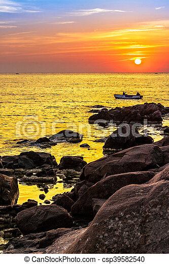 fishermen in the boat at sunrise - csp39582540