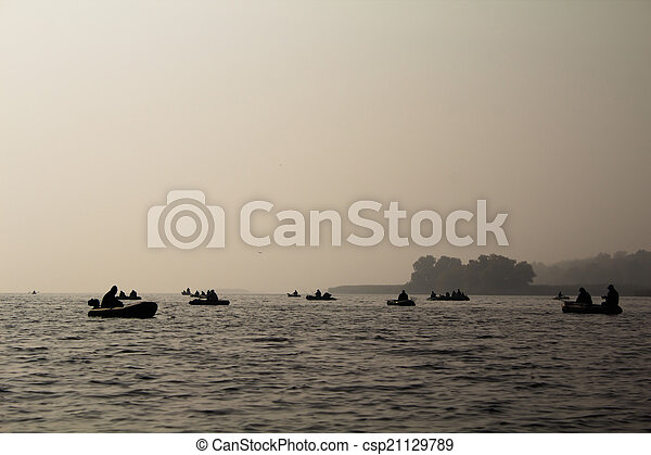 Fishermen on a boat in the fog - csp21129789