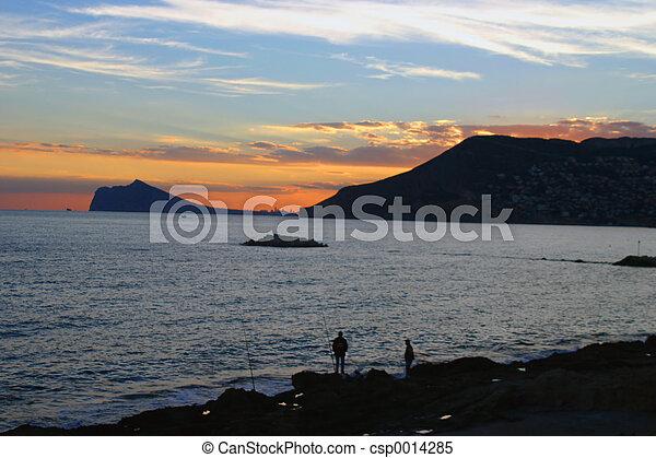 fishing at sunset - csp0014285