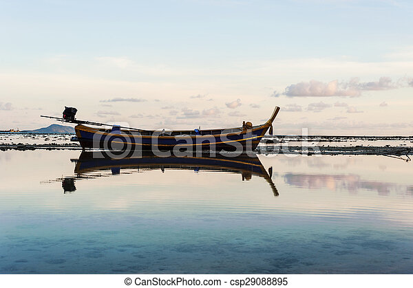 Fishing boat in the sea with morning light - csp29088895