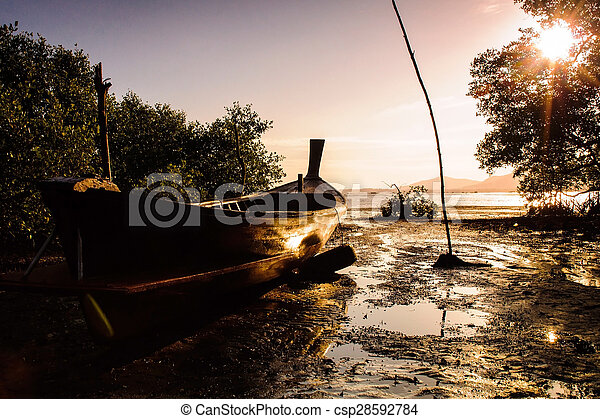 Fishing boat with color of sunset - csp28592784