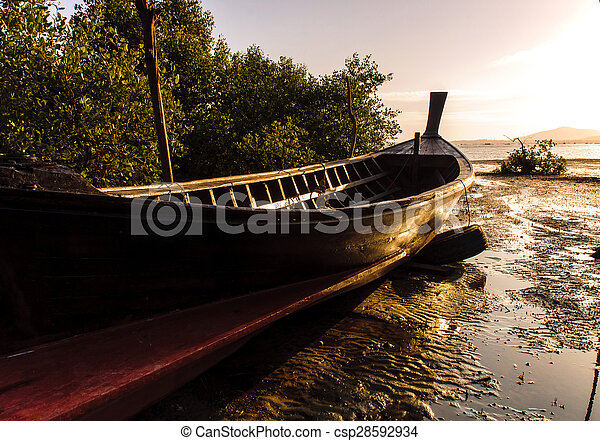 Fishing boat with color of sunset - csp28592934