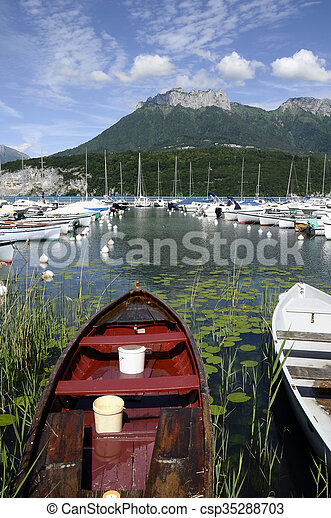 Fishing boats on Annecy lake, France - csp35288703