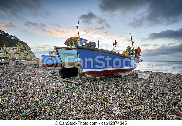 Fishing boats on the beach at Beer in Devon - csp12874345
