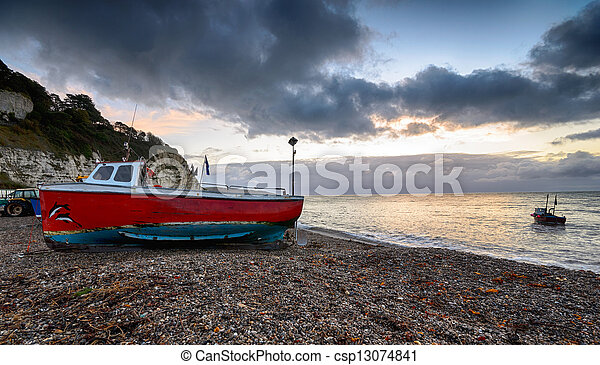 Fishing boats on the beach at Beer in Devon - csp13074841