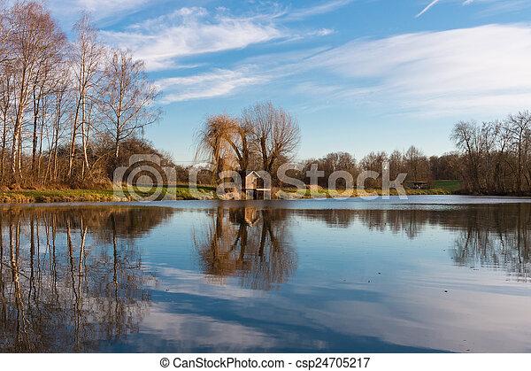 Fishing hut at a lake - csp24705217