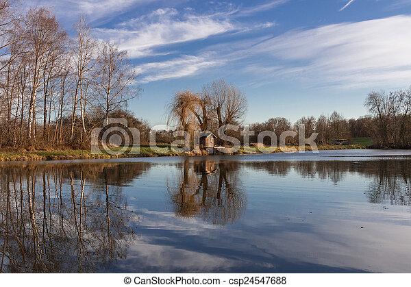 Fishing hut at a lake - csp24547688