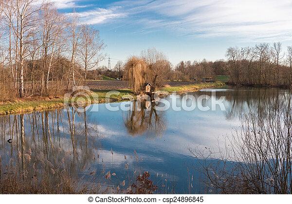 Fishing hut at a lake - csp24896845