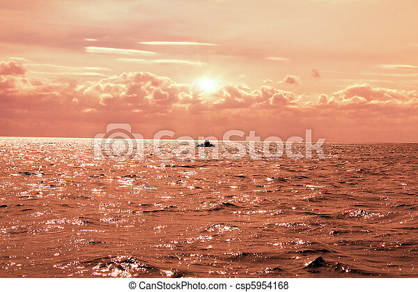 fishing in the lake at sunset - csp5954168