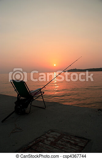 fishing in the sunset - csp4367744