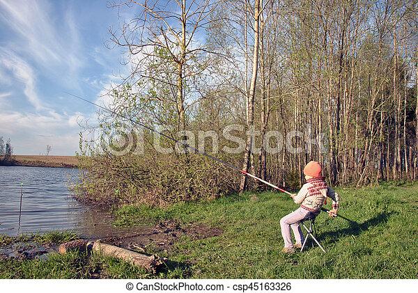 Fishing - lovely girl fishing on the lake - csp45163326