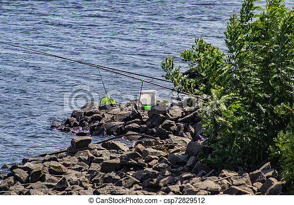 Fishing on the shore without a fisherman. - csp72829512