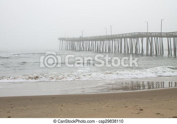 Fishing Pier in Fog - csp29838110