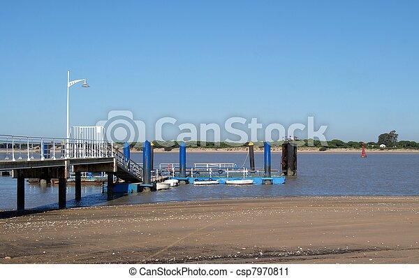 fishing pier in the beach - csp7970811
