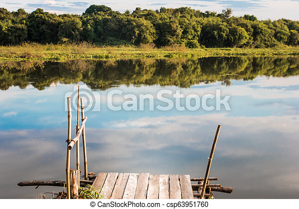 Fishing pier on the lake. - csp63951760