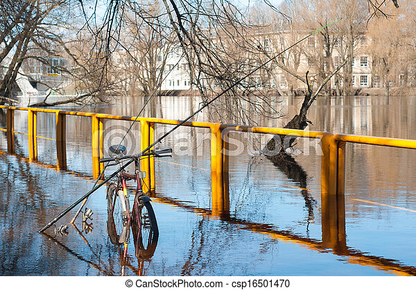 Fishing poles relied on bicycle in flooded river - csp16501470