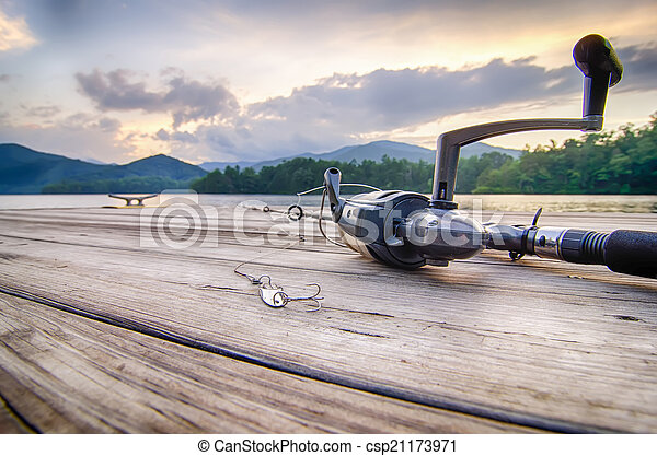 fishing tackle on a wooden float with mountain background in nc - csp21173971