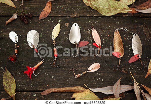 Fishing tackle on wooden surface. - csp16503829