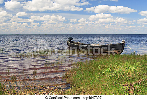 Fishing wooden boat in Lache lake, north Russia - csp4647327