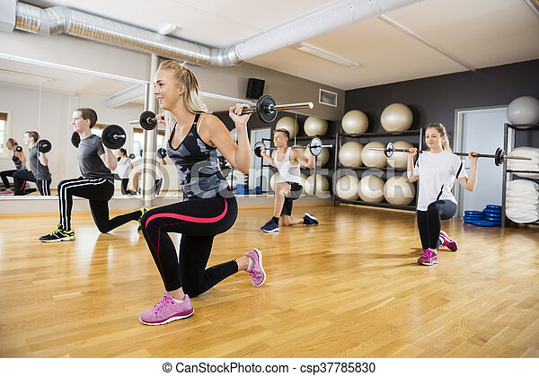 Fit Friends Lifting Barbells In Gym - csp37785830
