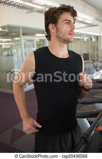 Fit man jogging on the treadmill - csp20436569