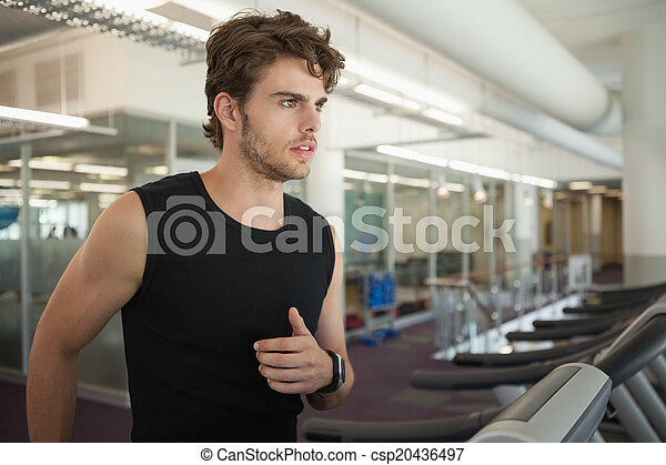 Fit man jogging on the treadmill - csp20436497