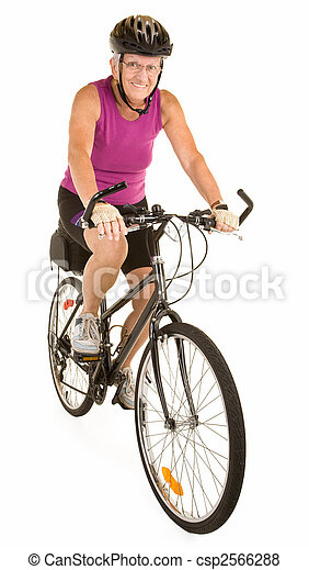 Fit Senior Woman Riding a Bicycle - csp2566288