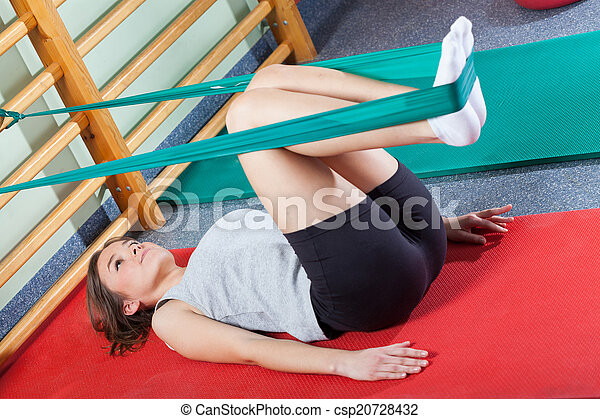 Fit woman exercising in fitness studio - csp20728432