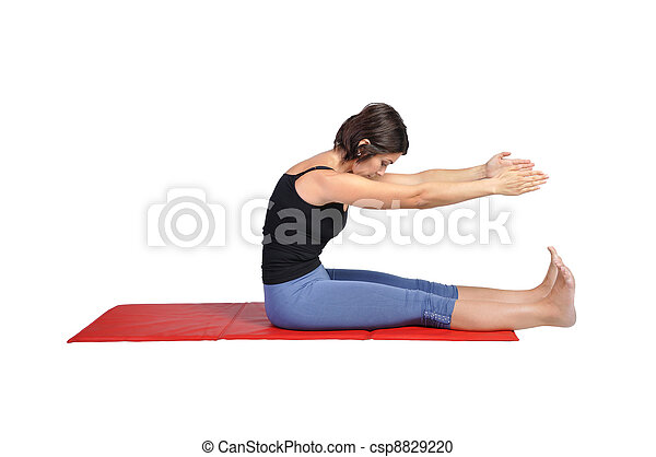 Fit young female pilates instructor - csp8829220