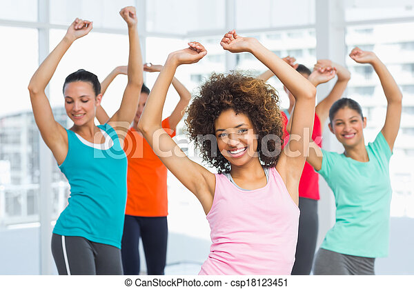 Fitness class and instructor doing pilates exercise - csp18123451