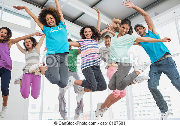 Fitness class and instructor doing pilates exercise - csp18127501