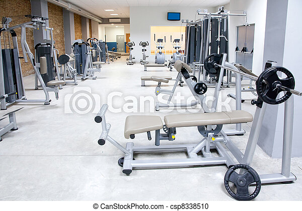 Fitness club gym with sport equipment interior - csp8338510