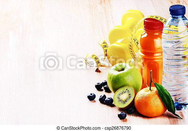 Fitness concept with dumbbells and fresh fruits - csp26876790