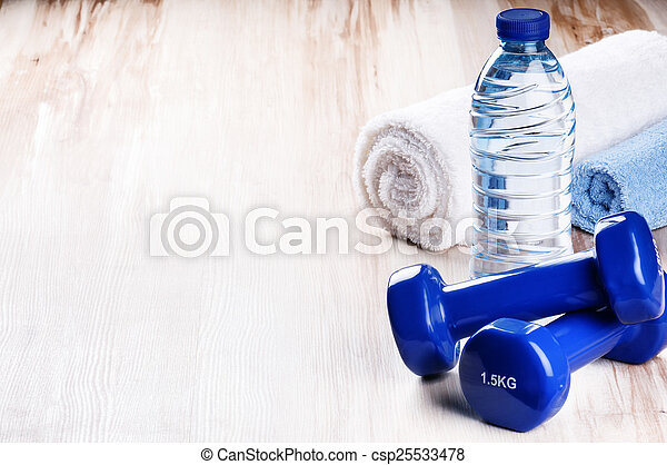 Fitness concept with dumbbells and water bottle - csp25533478