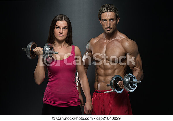 Fitness Couple Exercise Biceps - csp21840029