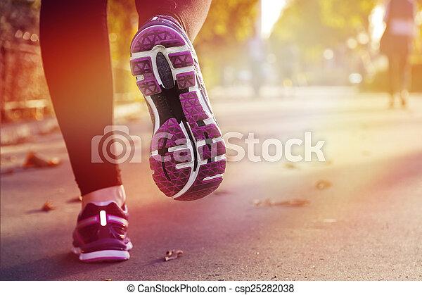 Fitness Girl running at sunset - csp25282038