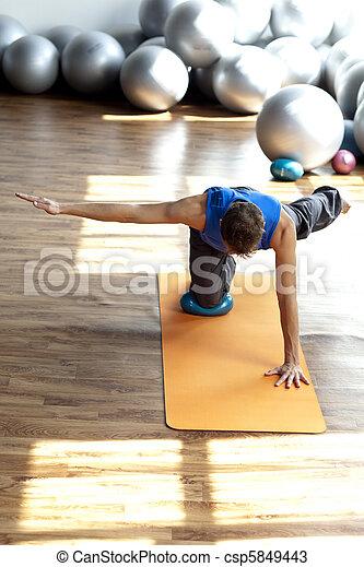fitness - man practicing pilates - csp5849443