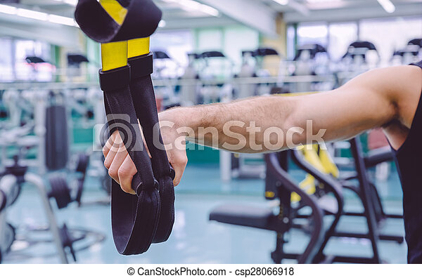 Fitness straps in the hand of man training - csp28066918