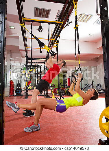 Fitness TRX training exercises at gym woman and man - csp14049578