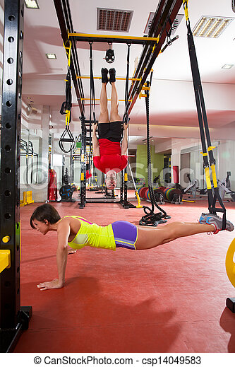Fitness TRX training exercises at gym woman and man - csp14049583