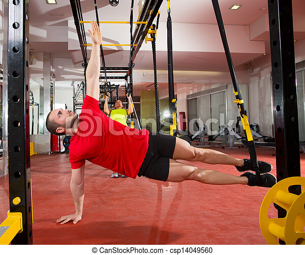 Fitness TRX training exercises at gym woman and man - csp14049560