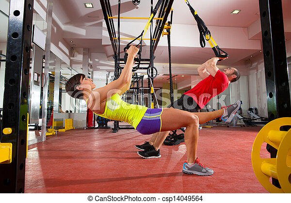 Fitness TRX training exercises at gym woman and man - csp14049564