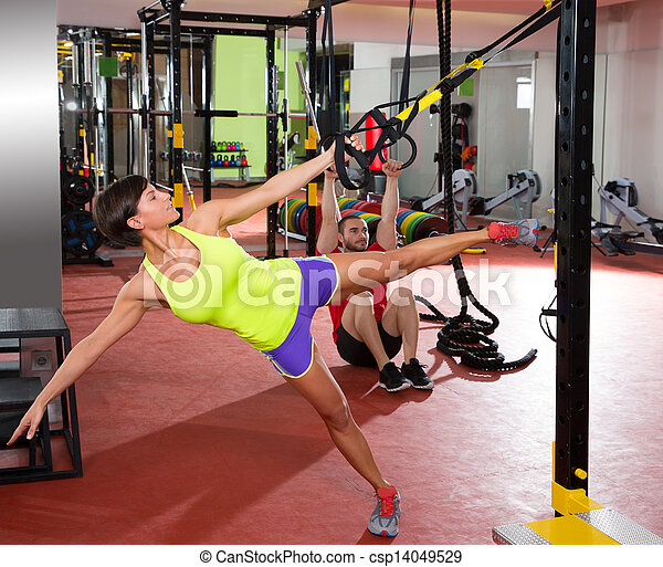 Fitness TRX training exercises at gym woman and man - csp14049529